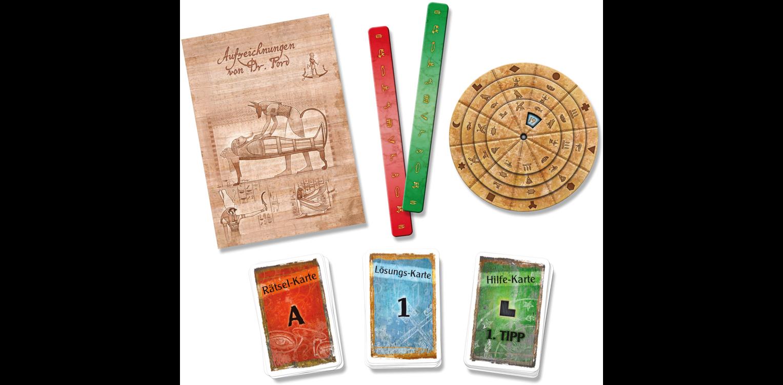 Exit Spielmaterial die Grabkammer des Pharao: Neben den Aufzeichnungen im Rätselbuch, den Kartensätzen und der Decodierscheibe gibt es nur wenig Spielmaterial